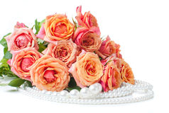 Orange roses and pearls Royalty Free Stock Photos