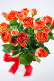 Orange roses in vase Royalty Free Stock Photography