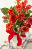 Orange roses in vase Stock Image