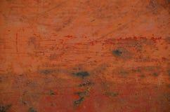 Orange Rost mit Kratzern Stockfotografie