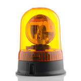Orange rotating beacon. On white reflective background Stock Photography