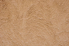 Orange rough plaster on wall Royalty Free Stock Images