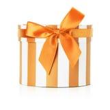 Orange round gift box isolated on the white background Royalty Free Stock Photos
