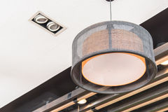Orange round stylish lampshades hang from ceiling Stock Photography