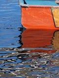 Orange rowboat Stock Image
