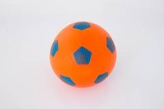 Orange rubber ball. On white background Stock Images