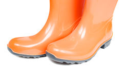 Orange rubber boots isolated on white Royalty Free Stock Images