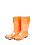 Orange rubber boots isolated on white Royalty Free Stock Photo