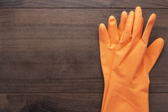 Orange rubber cleaning gloves Stock Images