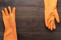 Orange rubber cleaning gloves Stock Photo