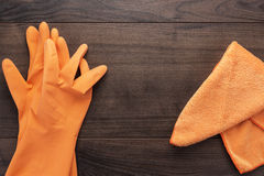 Orange rubber cleaning gloves Royalty Free Stock Images