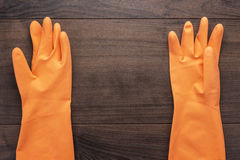 Orange rubber cleaning gloves Royalty Free Stock Photography
