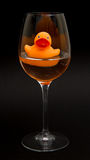 Orange rubber duck in a wineglass Stock Photography
