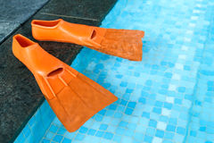 Orange Rubber flippers in pool royalty free stock photos