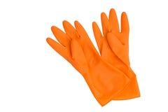 Orange rubber gloves isolated on white Stock Photo