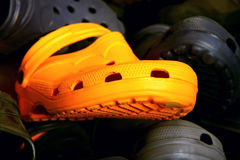 Orange rubber shoes Stock Photo