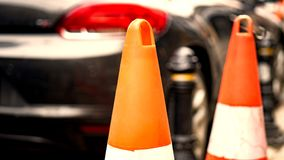 Orange rubber traffic cone on country road. It is used for warning to broken down car royalty free stock photography