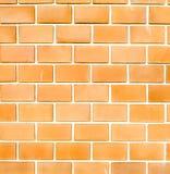 Orange ruled brick wall texture background Stock Photography