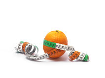 An orange and ruler Royalty Free Stock Photography