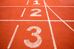 Orange running track with number.  Stock Image