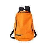 Orange ryggsäck som isoleras med banan Royaltyfri Foto