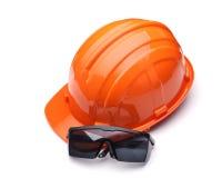 Orange säkerhetshjälm och skyddsglasögon Royaltyfri Foto