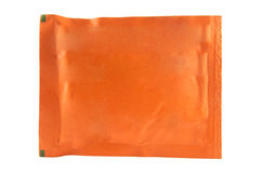 Orange sachet on white background Stock Image