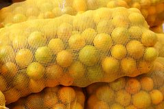Orange sack citrus stacked fruits Royalty Free Stock Images