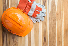 Orange safety engineer helmet gear and gloves Royalty Free Stock Photo