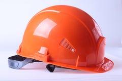 Orange safety hard hat, isolated on white background. Royalty Free Stock Images