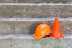 Orange safety helmet and cone Stock Photos