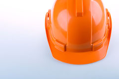 Orange safety helmet hard hat, tool protect worker Royalty Free Stock Photo