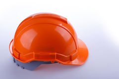 Orange safety helmet hard hat, tool protect worker. Of danger in construction industry Royalty Free Stock Photo