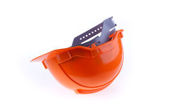 Orange safety helmet hard hat, tool protect worker of danger Royalty Free Stock Photography