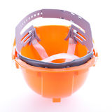 Orange safety helmet hard hat, tool protect worker. Of danger in construction industry on white background Royalty Free Stock Photo