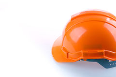 Orange safety helmet hard hat, tool protect worker. Of danger in construction industry on white background Royalty Free Stock Image