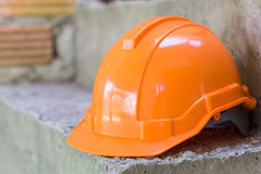 Orange safety helmet, safety equipmen Stock Photos