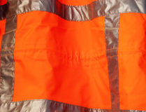 Orange safety vest. Abstract textile royalty free stock image