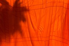 Orange and saffron robes of Buddhist monks hanging on wooden.Tha. Iland Royalty Free Stock Photo