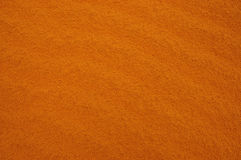 Orange sand. Detail of an orange sand background Stock Photos