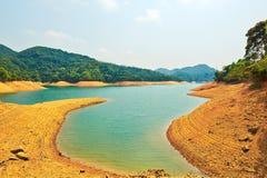 Orange sand and cyan lake Stock Photography