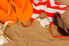 Orange Sandals And Shells Stock Photo