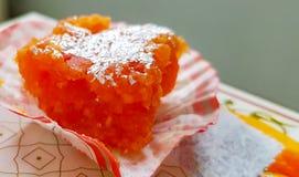 Orange sandesh mithai ladoo barfi sweet dish dessert india stock photo
