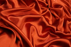 Orange satin background Royalty Free Stock Photos