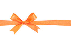 Orange satin gift bow ribbon Stock Photography