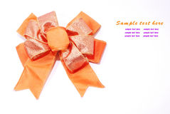 Orange satin ribbon on white Stock Image
