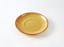 Orange saucer Royalty Free Stock Image