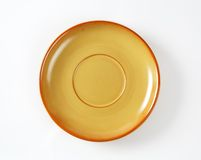 Orange saucer Royalty Free Stock Photo