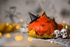 Orange scary pumpkin with witch hat. Closeup. Orange scary pumpkin with witch hat. Halloween background. Closeup stock image