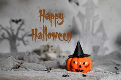 Happy Halloween. Orange scary pumpkin with witch hat. Halloween. Orange scary pumpkin with witch hat. Halloween background. Closeup stock image